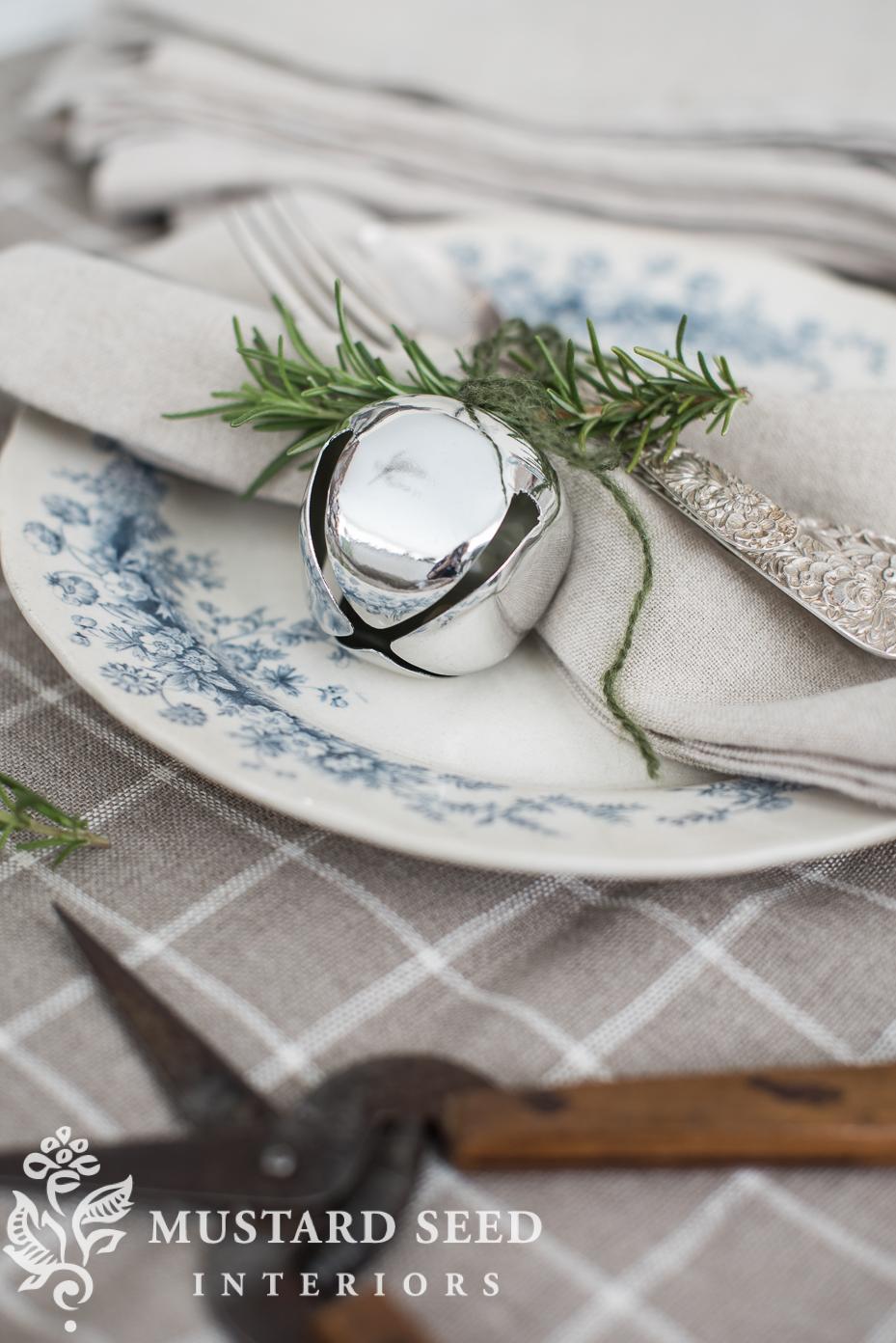 silver sleigh bell napkin holder | decorate with sleigh bells | missmustardseed.com