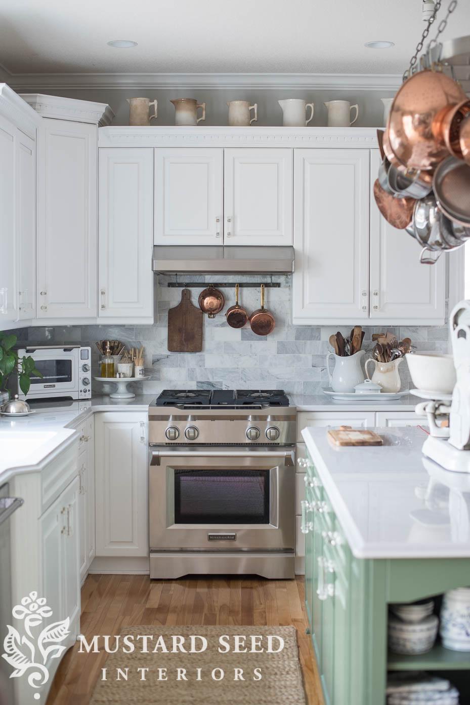 white kitchen | marble backsplash | green kitchen island | decorating ideas | trends | miss mustard seed