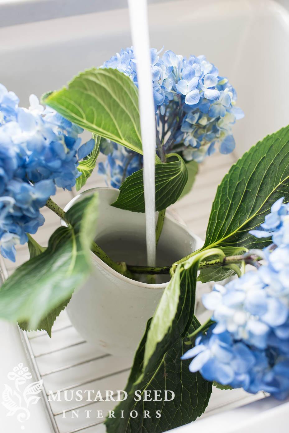white sink blue hydrangeas miss mustard seed