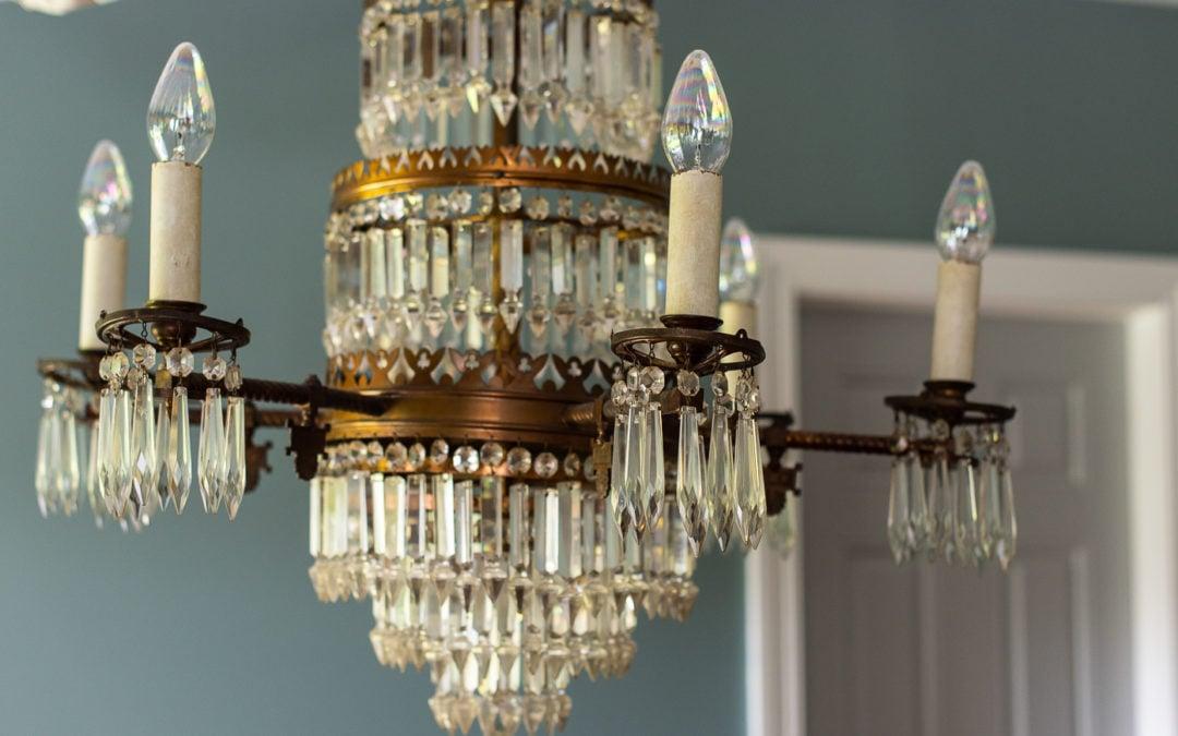 basement family room makeover | 1800's chandelier