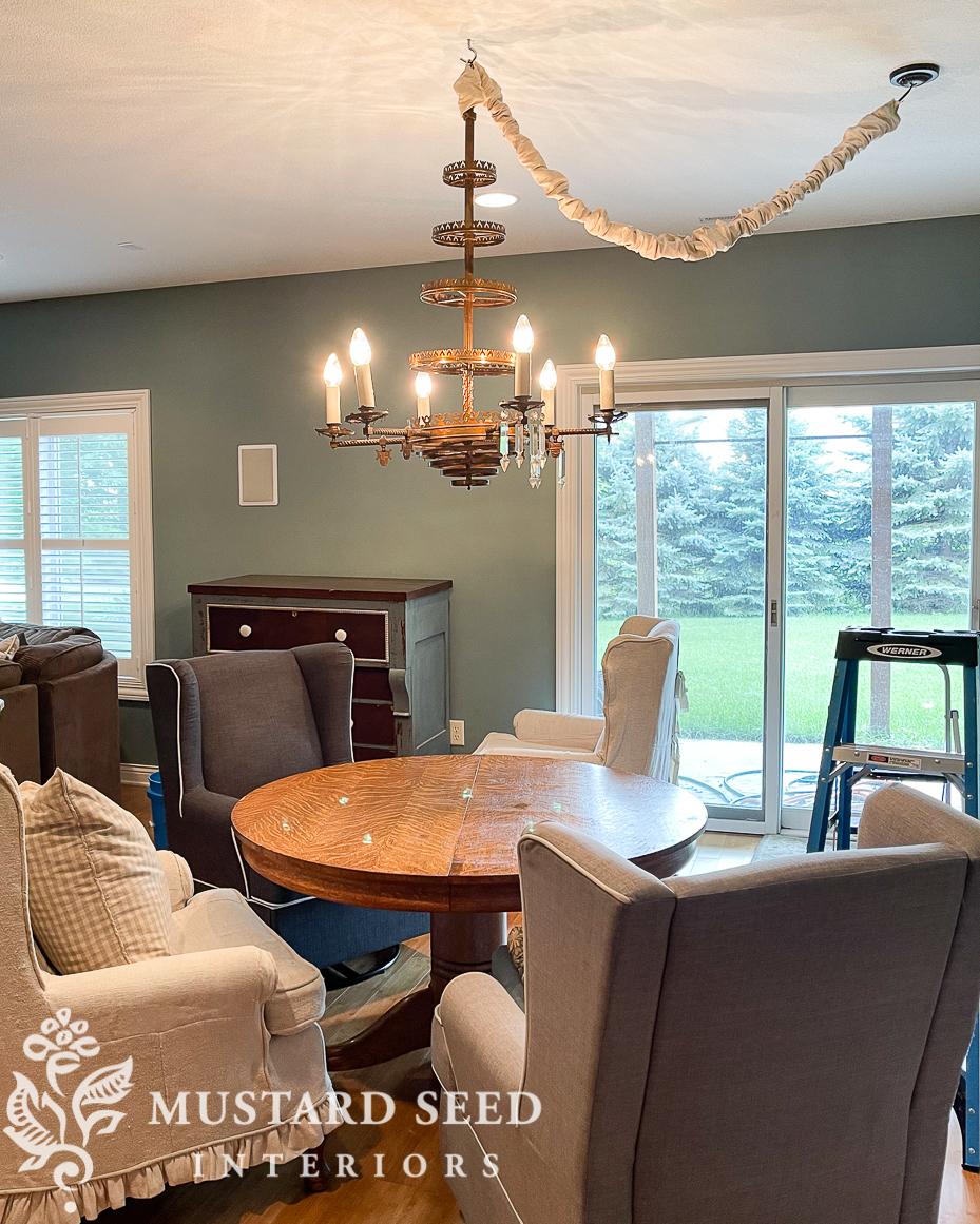 basement family room makeover   1800's chandelier   miss mustard seed