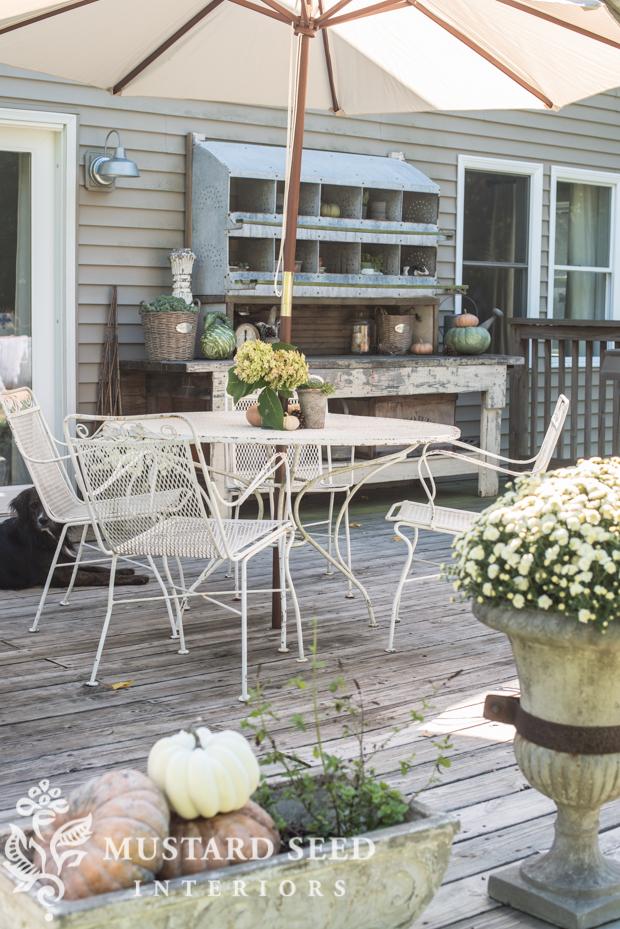 patio umbrella | farmhouse fall porch | missmustardseed.com