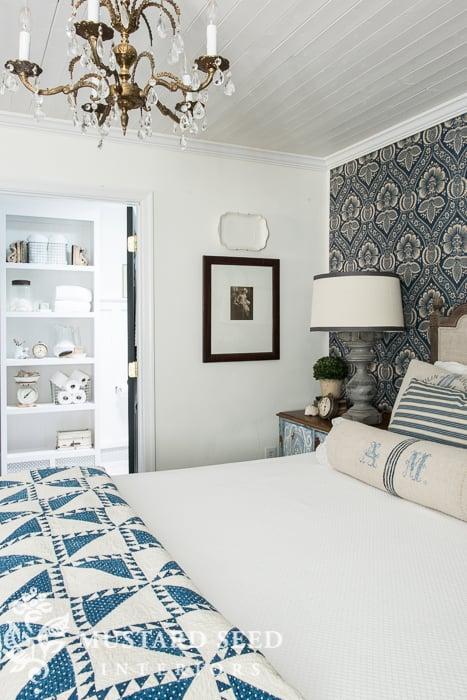 blue and white bedroom | framed family photo