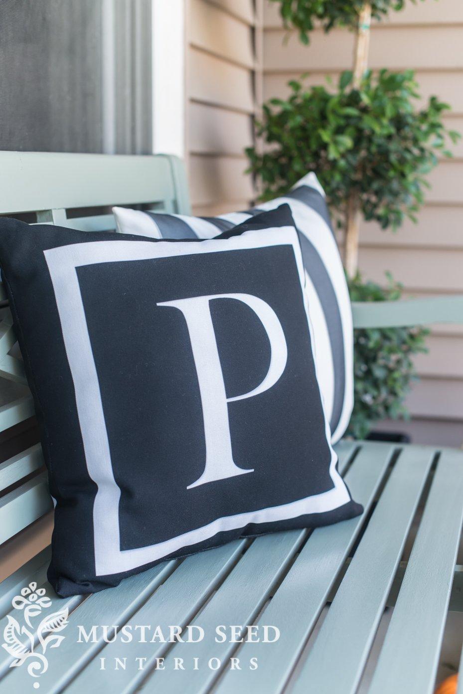 black stripe and monogram pillows | decorating fall porch | missmustardseed.com